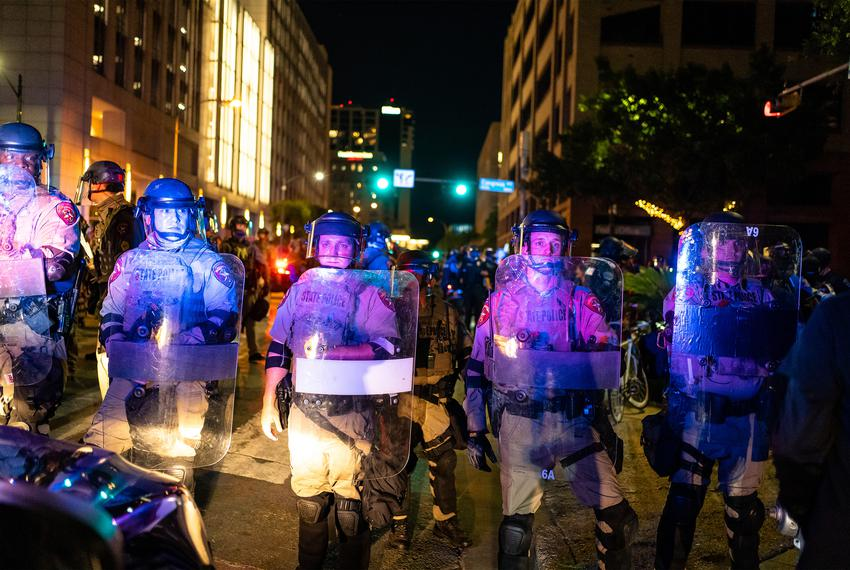 State police in riot gear block protesters from gathering in the street in downtown Austin on Aug. 1, 2020.