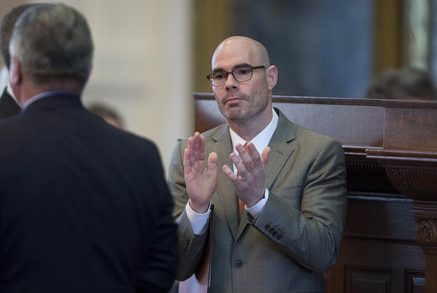 State Rep. Dennis Bonnen, R-Angleton, celebrates passage of his tax cut measures during the House session April 28, 2015.