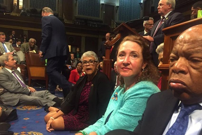 A photo shot and tweeted from the floor of the House by U.S. House Rep. David Cicilline shows Democratic members of the U.S…