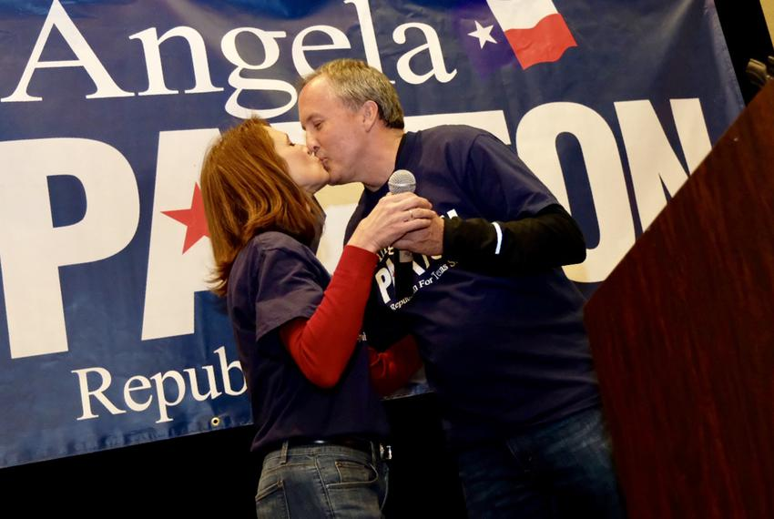 Angela Paxton kisses her husband, Texas Attorney General Ken Paxton, at her primary election night watch party in Allen on T…