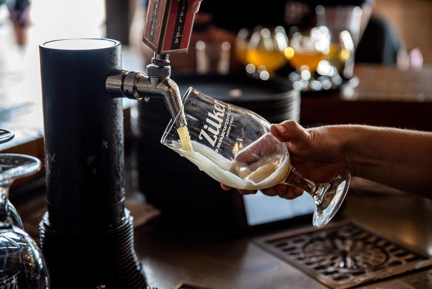 """Red"" Godwin pours a beer behind the bar at Zilker Brewery in Austin, Texas on Wednesday, Junes 26, 2019. Texas Governor Gre…"