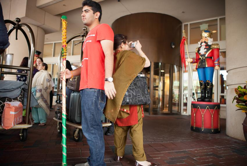Canadian Nikhil Sabharwal, with a Punjabi dance stick used in wedding celebrations, stands outside a hotel after attending a…
