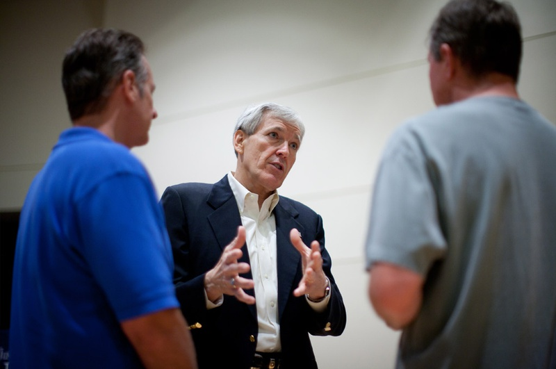 5/12/12  Texas U.S. Senate candidate Tom Leppert talks to members of the community (left and right) Michael Osuna and Steve Chappell  at the Christ Fellowship Church in  McKinney, TX during a candidate meet and greet.