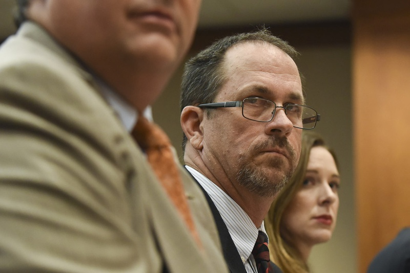 Texas Education Agency investigator Doug Phillips testifies on punishing educators for inappropriate student-teacher relationships during a public hearing Dec. 7, 2015 before the Senate Education Committee.