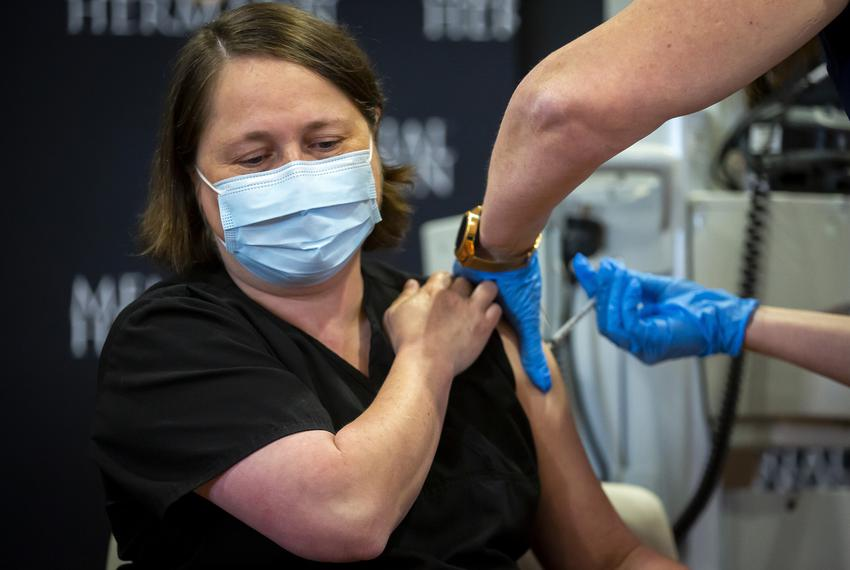 Infectious Disease Specialist Dr. Linda Yancey receives the fifth Pfizer COVID-19 vaccine at Memorial Hermann Hospital in th…