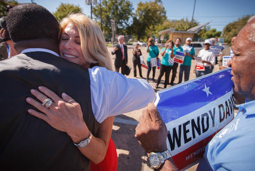 Democratic gubernatorial candidate Wendy Davis greeted voters while campaigning outside an early voting polling place in H...