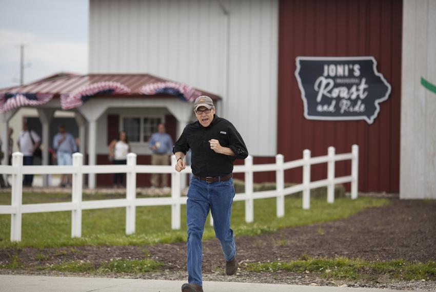 Rick Perry runs to the stage at the Roast and Ride in Boone, Iowa.