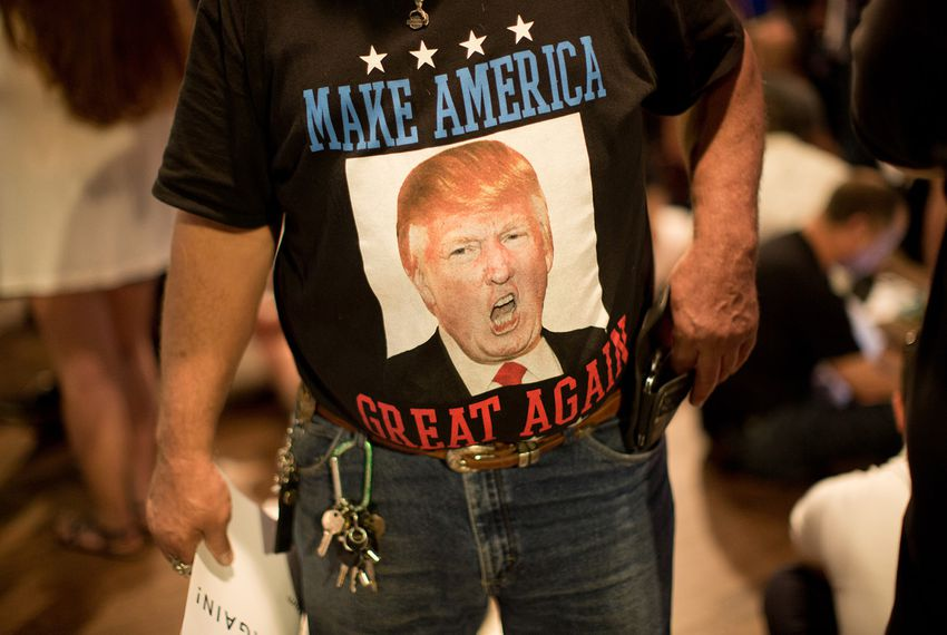 A Trump fan waits for a Donald Trump rally to begin at Gilley's in Dallas on June 16, 2016.
