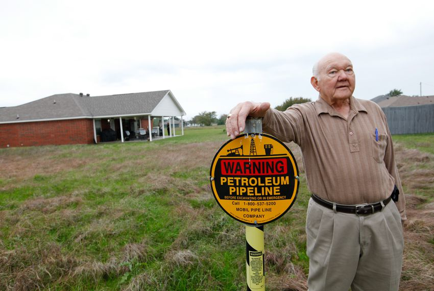 Jim Howell stands on the easement of the Exxon Mobile Pegasus pipeline which runs through his property in Gun Barrel City on Tuesday, Nov. 5, 2013.