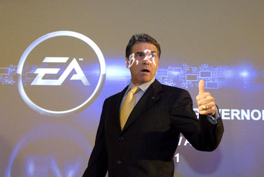 Gov. Rick Perry walks in front of a projection screen at BioWare Corp. EA Games after making an economic development annou...