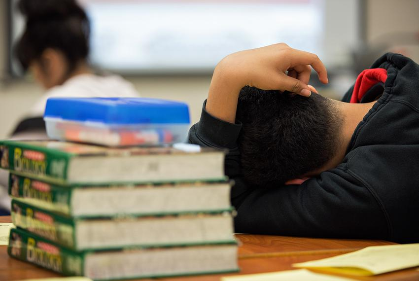 A student lays his head down during the class lesson at the after school intervention program on April 19, 2018.