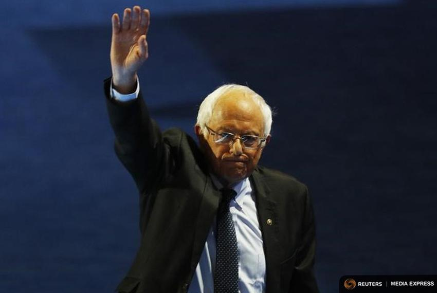 Senator Bernie Sanders of Vermont waves while leaving the stage after addressing the Democratic National Convention in Phila…