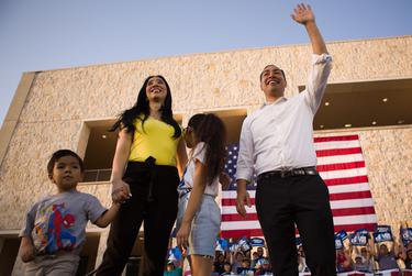 Julián Castro and his family wave to the crowd at a rally in San Antonio after an earlier visit by President Donald Trump, on April 10, 2019.