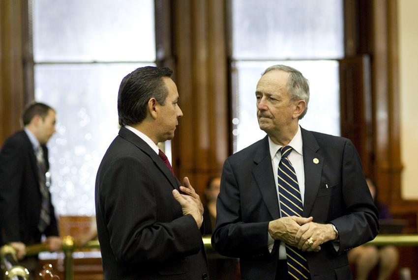 With rain pouring down outside the Senate chamber, State Sen. Jeff Wentworth (r), R-San Antonio, speaks with State Sen. Ca...