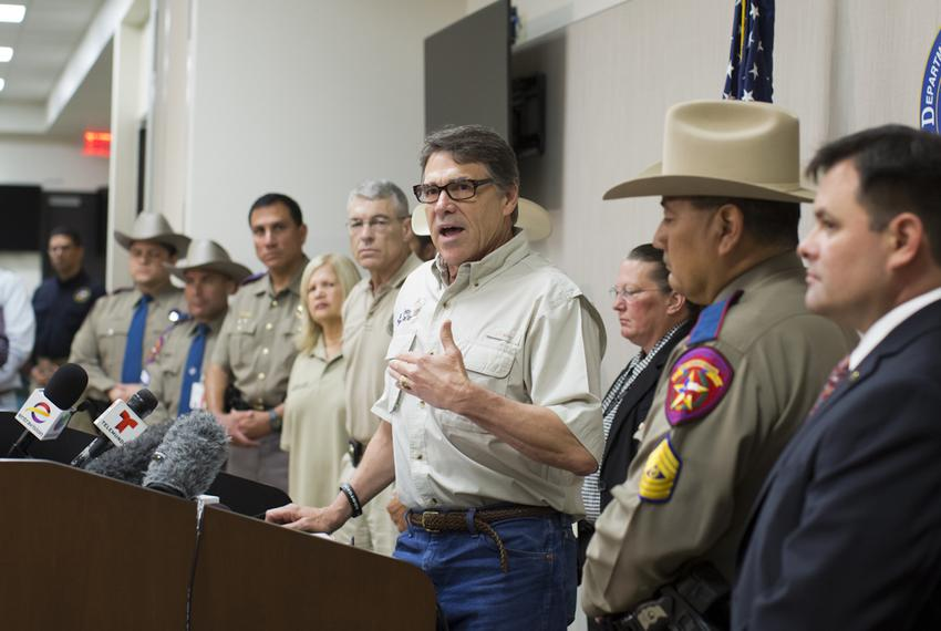 Gov. Perry and DPS Director Steve McCraw, speak to media following a tour to a federal facility housing unaccompanied alie...