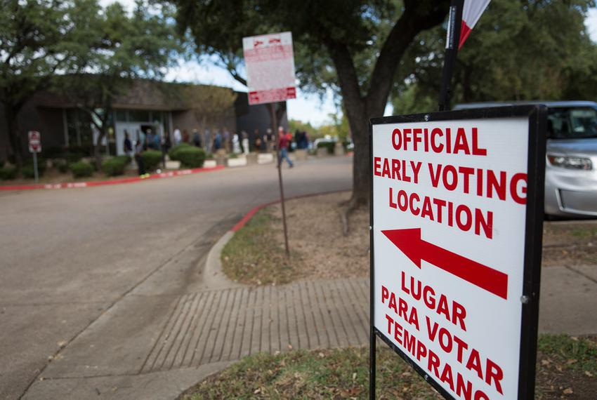 Voters line up outside the Oak Cliff Sub-Courthouse in Dallas, Texas, for the first day of early voting on Monday, Oct. 24, …