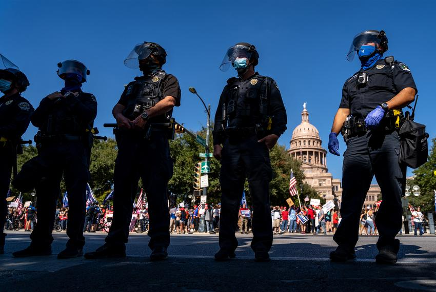 Austin Police Department officers in riot gear showed up at the Texas State Capitol as dueling rallies develop for President…