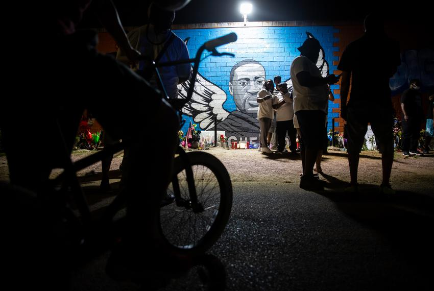 People gather at the mural for George Floyd in the Third Ward in Houston on June 8, 2020.