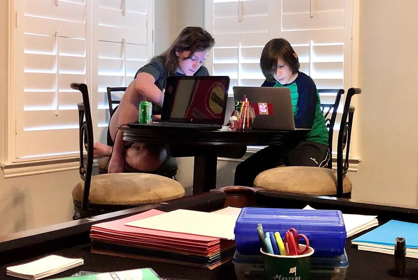 Genevieve Gilmore, 14, studies with her brother Charlie, 11, in their home in Celina.
