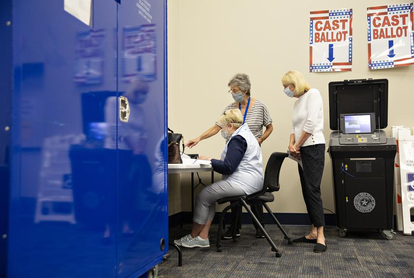 Connie Ford, middle, assists Ann Massey, left, and Linda Frageman, right, at a training lab at the Collin County Elections D…