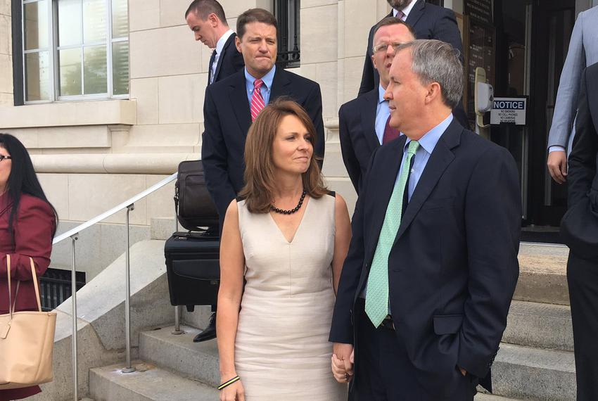 Texas Attorney General Ken Paxton, with his wife Angela Paxton, makes brief remarks to reporters after a hearing in his SEC …