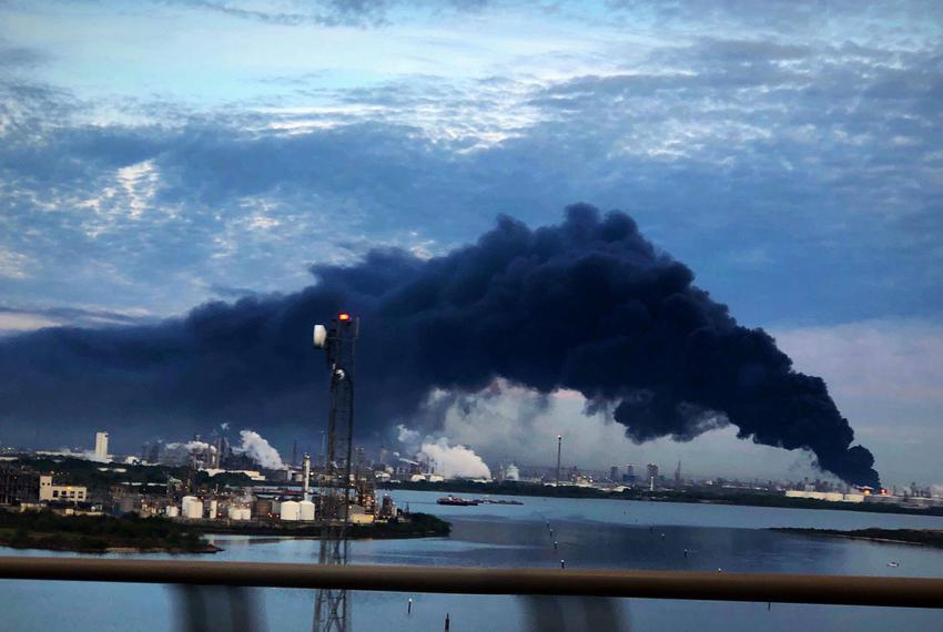 Smoke rises from a fire burning at the Intercontinental Terminals Company in Deer Park, east of Houston on March 18, 2019.