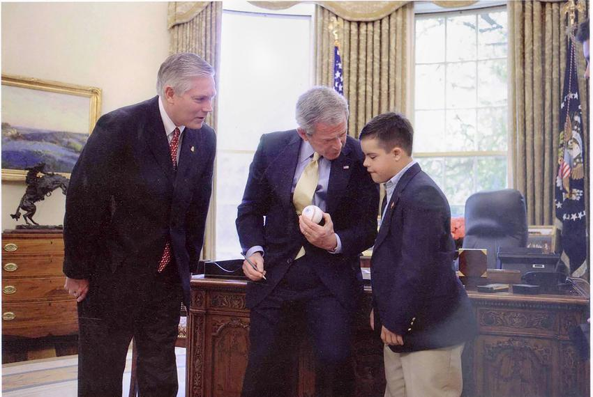 Alex Sessions, right, father of U.S. Rep. Pete Sessions, left, meets President George W. Bush, center, before the passage ...
