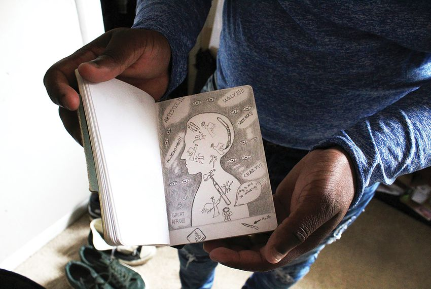 Keilan Banks shares his sketches. Christopher Collins/Texas Observer