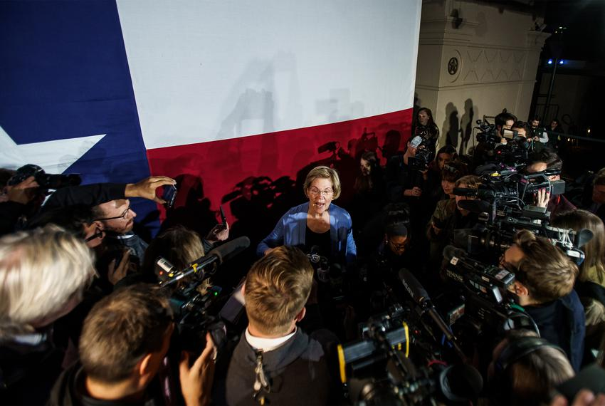 Presidential candidate Elizabeth Warren takes questions from reporters following a town hall event in San Antonio on Feb. ...