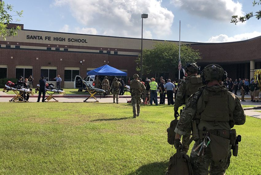 Deputies from the Harris County Sheriff's Office on the scene of Santa Fe High School, where a shooting occurred Friday morning.