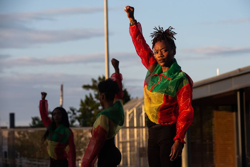 Crystal Aitaegbebhunu and her dance partners rqn through their choreography for a Juneteenth black empowerment video at Eman…
