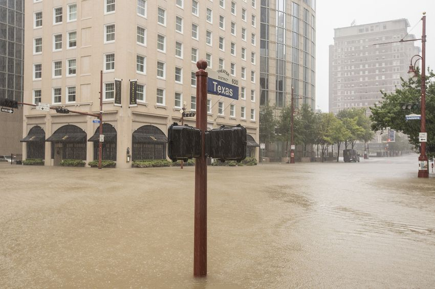 The Theater District in downtown Houston on Sunday, Aug 27, 2017, is flooded by water from Buffalo Bayou.