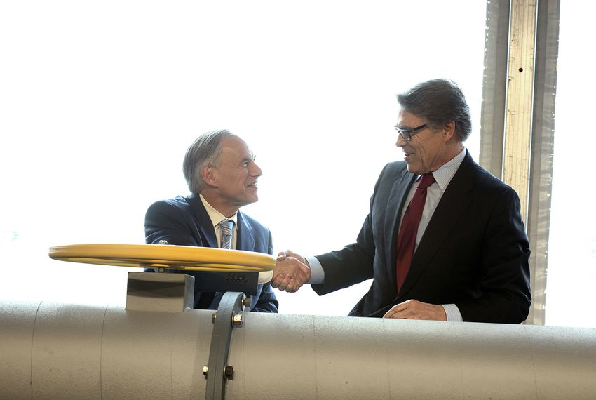 Texas Gov. Greg Abbott, left, and U.S. Secretary of Energy Rick Perry appeared at a ribbon cutting ceremony at the Petra Nova Power Plant in Thompsons on April 13, 2017.
