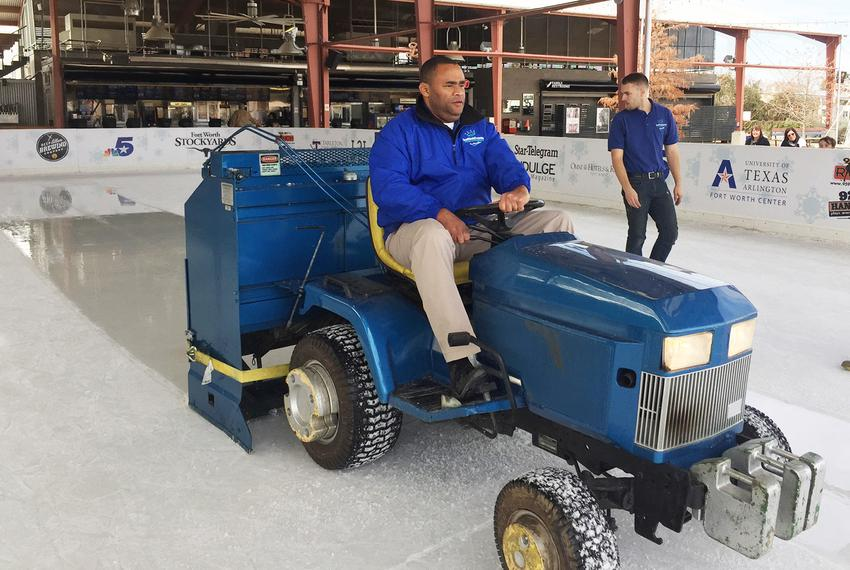 U.S. Rep. Marc Veasey, D-Fort Worth, operates an ice-resurfacing machines at a Fort Worth ice skating rink on Dec. 21, 201...