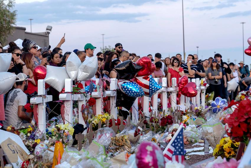 Hundreds mourn for the victims and their family outside the El Paso Walmart where a mass murderer killed 22 people.