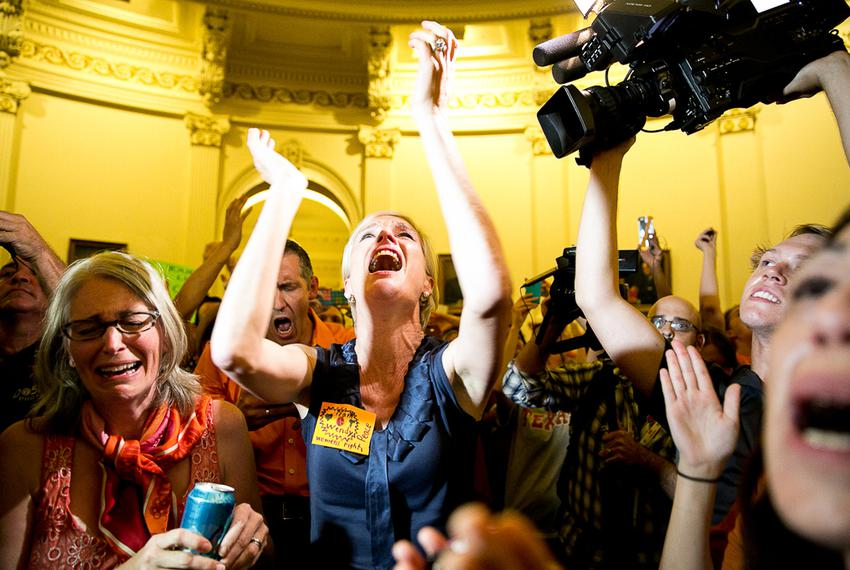 Cecile Richards, president of the Planned Parenthood Federation of America, cheering with activists to disrupt the last mi...