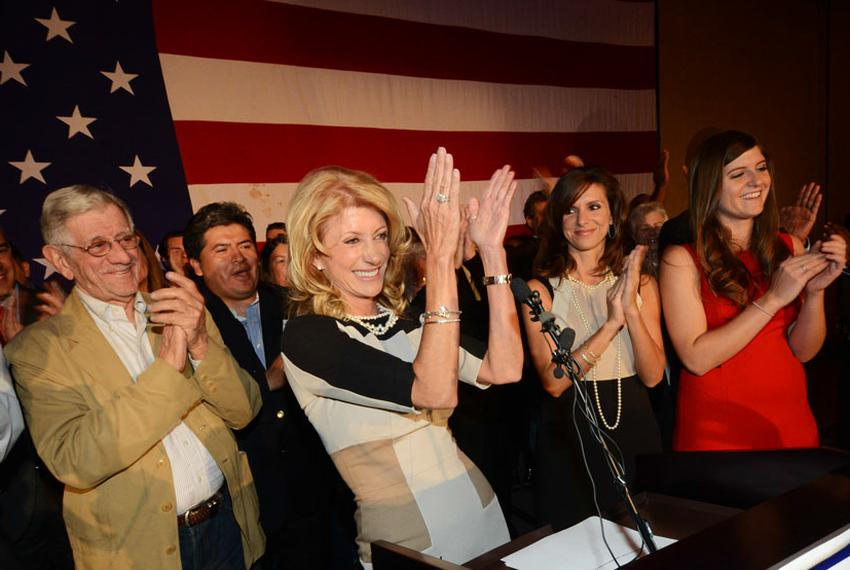 State Sen. Wendy Davis, flanked by her father, Jerry Russell, and her two daughters, delivering her victory speech at the Fo…