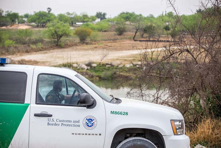Border Patrol Agent Isaac Villegas looks out at the Rio Grande outside of Roma, Texas.