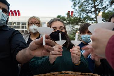 Volunteers light candles at Discovery Green on March 20, 2021, in Houston. People gathered for the Stop Asian Hate Vigil and Rally after a man killed eight, including six Asians, in a mass shooting at three Atlanta spas.