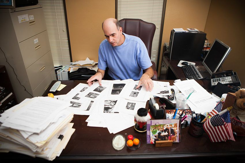 Victim Advocate for the City of Houston Andy Kahan, with crime scene photos printed off websites showing dead bodies, many unclothed, in his office at the Houston Police Department in Houston, Monday May 6, 2013.