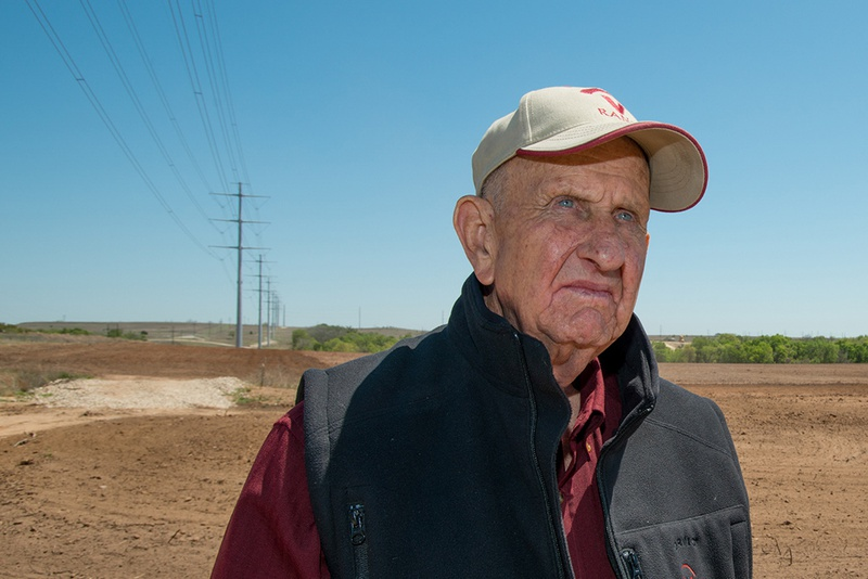 Johnny Vinson stands on the part of his Wise County, Texas ranch where Oncor built a power line  through his property. Vinson says the power company didn't build the line where it was approved.