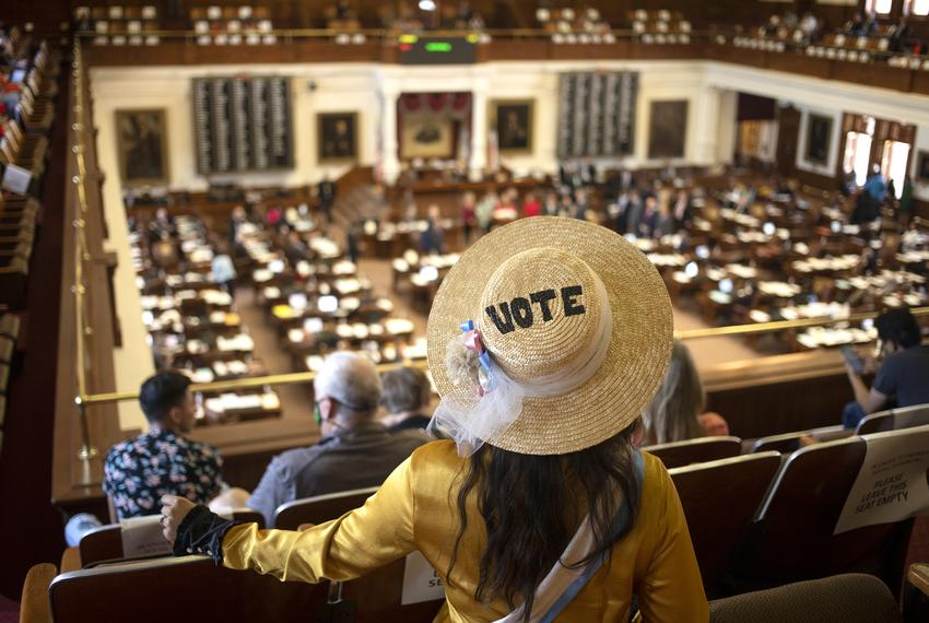 A visitor of the House gallery listens to legislators speak during a debate on an abortion bill being considered on the Hous…
