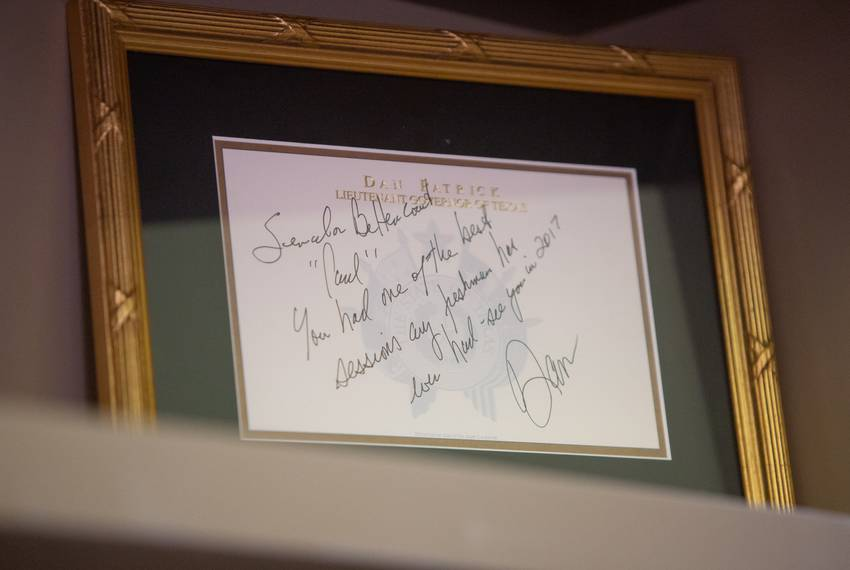 A framed note from Lieutenant Gov. Dan Patrick sits on a shelf in State Sen. Paul Bettencourt's office in the Capitol buid...