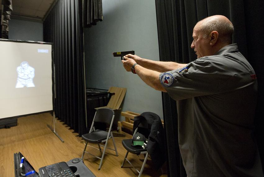 On The Mark Enhanced Tactical Training CEO Ray Dunn inside the Harrold ISD K-12 school where he teaches a gun training cla...