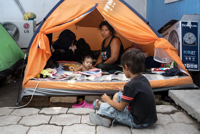 Vanessa Ramos Chavez rests in a tent at Senda de Vida migrant shelter in Reynosa, Tamaulipas. She arrived to the shelter f...