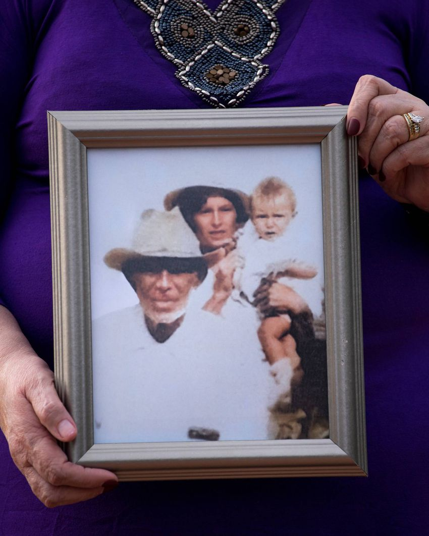 Arlinda Valencia, 68, holds a photograph taken in 1918 of her great-grandfather Longino Flores, left, great-grandmother Juan…