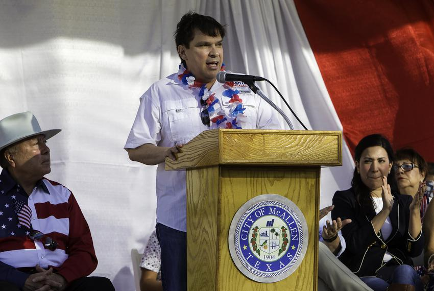 Congressman Vicente Gonzalez speaks to a crowd during the Fourth of July parade in McAllen.
