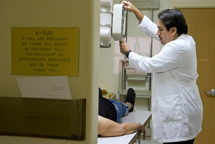 Dr. Javier Saenz treats a patient in his clinic in the Rio Grande Valley town of La Joya.