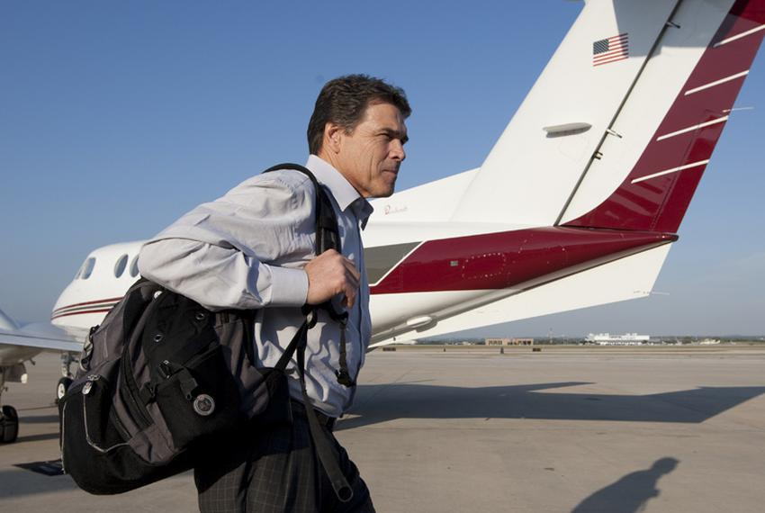 Texas Gov. Rick Perry departs a private plane at the San Antonio International Airport during a campaign stop on November ...