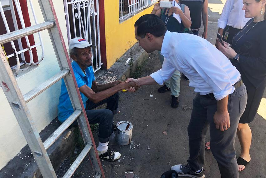 2020 presidential candidate Julián Castro greets a man in San Juan, Puerto Rico, whose home was damaged by Hurricane Maria...